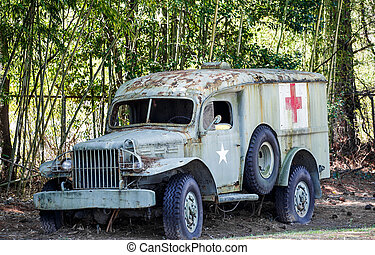 Old Medic Truck by Bamboo and Security Fence - An old medic...