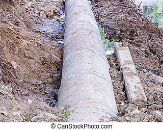 Concrete drainage pipes - Placing construction a concrete...
