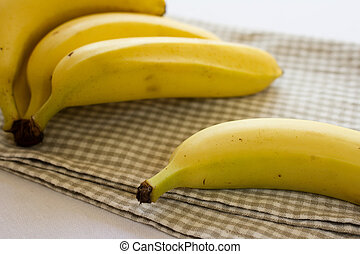 Ripe organic bananas - Fresh ripe organic bananas on a...