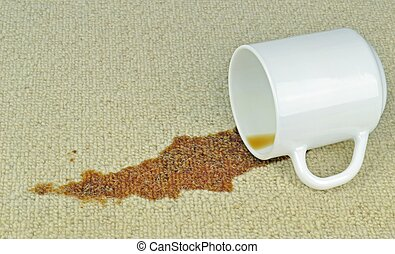A Spilled Cup of Coffee - A spilled cup of coffee on a...