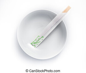 disposable chopsticks in empty bowl isolated on a white...