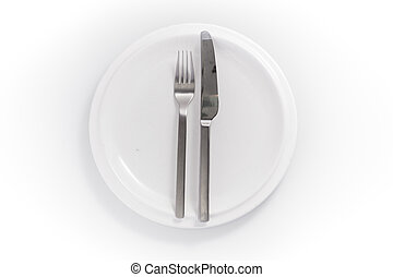 stainless knife and fork in a chine plate isolated on a white background