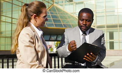 Client interaction - Experienced businessman interacting...