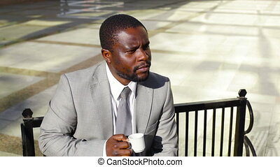 Pensive coffee drinker - Pensive business worker sitting on...