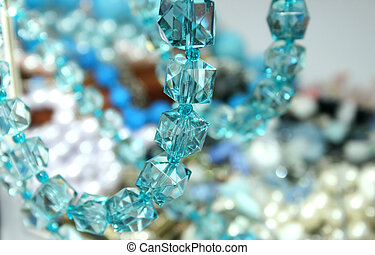 Necklace - Aquamarine necklace on the mirror.