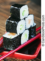 fresh roll served in a red plate with black stripes Focus on...