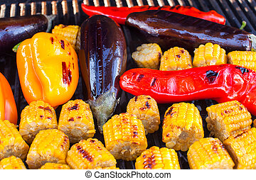 Close-up of  Vegetarian barbecue and cobs corn on the grill outdoors