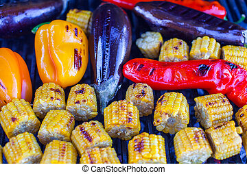 Close-up Vegetarian barbecue and cobs of corn on the grill outdoors