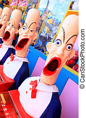 Side show carnival clowns with mouths open ready for play -...
