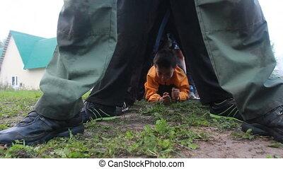 boy crawling underfoot other children