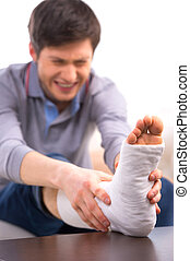 Man in pain - Man is suffering in pain while touching broken...