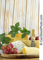 cheeseboard (Maasdam, Roquefort, Camembert) and grapes for...