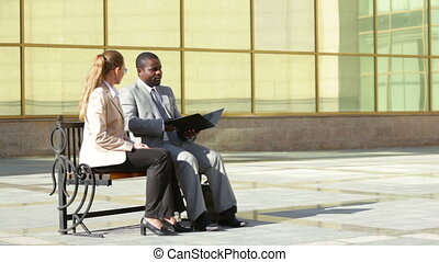 Outdoor meeting - African-American business meeting with his...