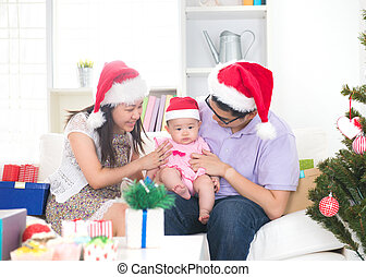 Asian young family celebrating christmas