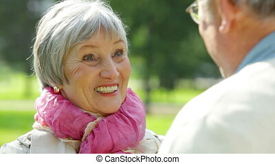 Elderly lady - Elegant senior lady talking to her friend on...