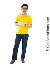 Full body Asian adult student in casual wear with school bag using digital computer tablet pc standing isolated on white background. Asian male model.