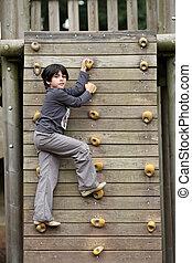 Climbing - Details of an outdoors climbing girl on a...