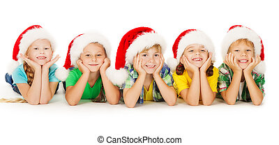 Christmas kids smiling in red hat lying down - Christmas...