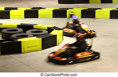Go-cart racing - Auto racing track with two motion blurred...