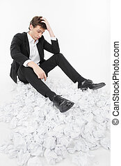 Man under stress - Man sitting on a lot of papers