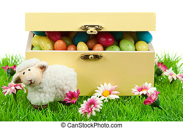 box of easter eggs and cute sheep