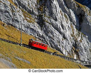 Mountain cogged railway leading to a peak of Mount Pilatus,...