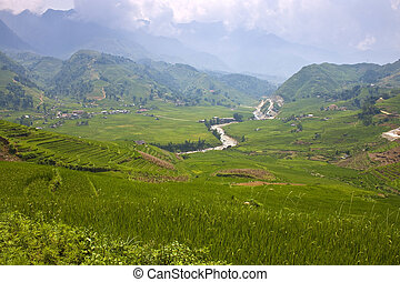 Paddy fields and small villages in mountains of northern Vietnam