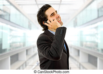 calling - young business man on the phone at the office