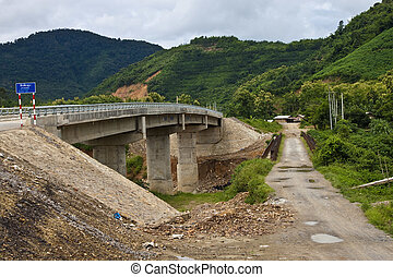 Old and new bridge in northern Laos