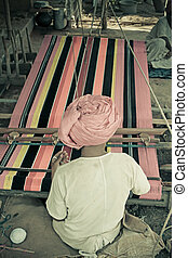 Man Making Ghongadi, desi blanket from sheep wool, India -...