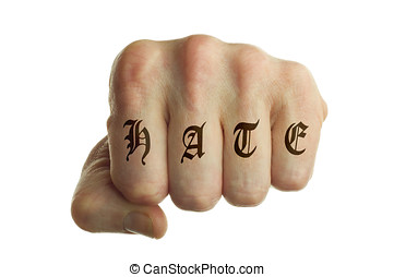 hate fist - isolated left fist with hate tattoo on fingers
