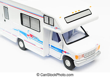 Camper - A toy camper on white