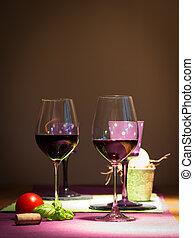 two redwine glasses with tomato and basil on table for...