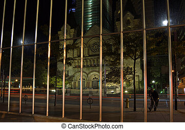 Reflection - View of catolic church on night street of...
