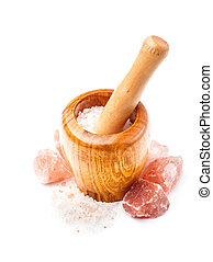 Himalayan pink salt in wooden mortar
