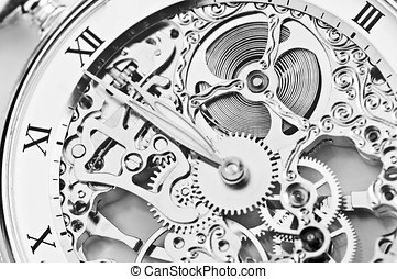 gearing - black and white close view of watch mechanism
