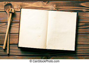 recipe book with stirring spoons - top view of recipe book...