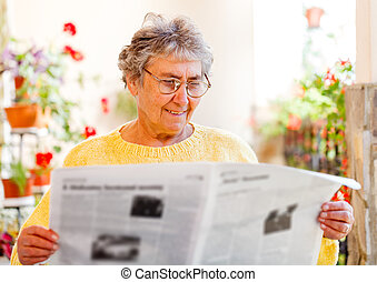 Elderly home care - Elderly woman sitting on the veranda and...