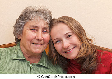 Mother and her daughter - Closeup portrait of mother and her...