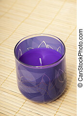 purple candle on a wooden background