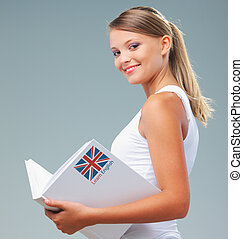 English female student holding a book