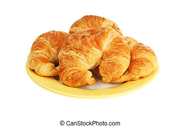 Croissants on a plate isolated on white