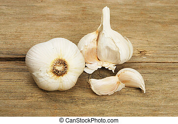 Garlic on wood - Garlic bulbs and cloves on rustic wood