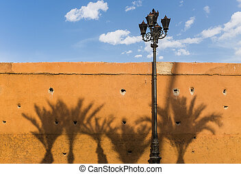 Marrakesh - Wall in the Medina of Marrakesh with shadows of...