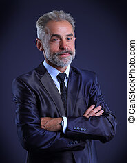 Portrait of adult business man isolated over dark background