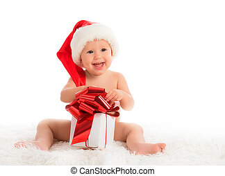 happy baby in a Christmas hat with a gift isolated on white...