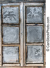 Window of country log house in village on winter