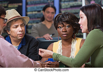 Perplexed Woman with Group in Cafe