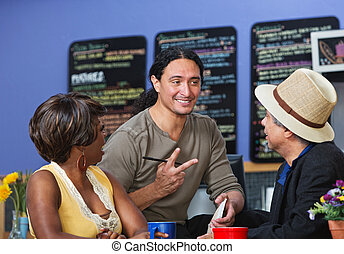 Handsome Man Taking Orders - Handsome cafe owner with...