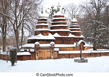 old wooden church in winter forest